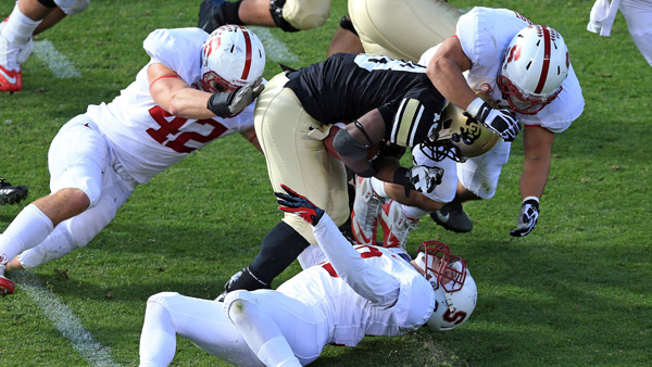 BOULDER, CO - NOVEMBER 03:  Running back Donta Abron #18 of the Colorado Buffaloes is tackled by the Stanford Cardinals defense at Folsom Field on November 3, 2012 in Boulder, Colorado. The Cardinal defeated the Buffaloes 48-0.  (Photo by Doug Pensinger/Getty Images)