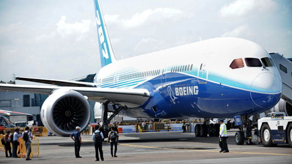 A Boeing 787 Dreamliner sits on the tarmac displayed at the Singapore Airshow  in Singapore on February 14, 2012. Boeing and Indonesian carrier Lion Air formally signed a 22.4 billion USD deal for 230 aircraft, the single largest contract in commercial aviation history.