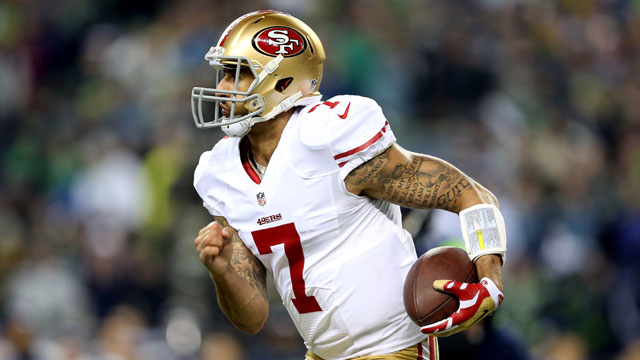SEATTLE, WA - JANUARY 19:  Quarterback Colin Kaepernick #7 of the San Francisco 49ers runs the ball in the fourth quarter while taking on the Seattle Seahawks during the 2014 NFC Championship at CenturyLink Field on January 19, 2014 in Seattle, Washington.  (Photo by Christian Petersen/Getty Images)