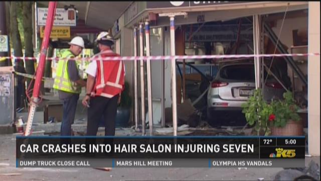 7 injured after car plows into hair salon