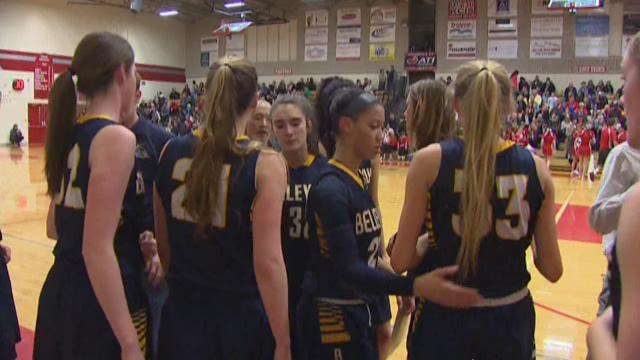 Sports reporter Chris Egan stands with the five seniors on the Bellevue High School girls basketball team.