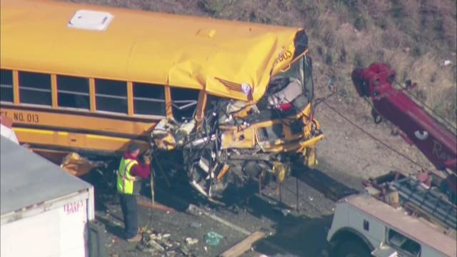 A truck, school bus and car were involved in a fatal