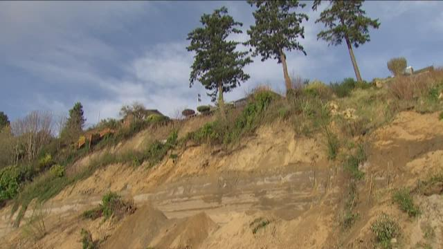 At least two houses were damaged in a landslide near