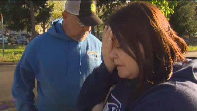 A parent and student reunite after a shooting at North