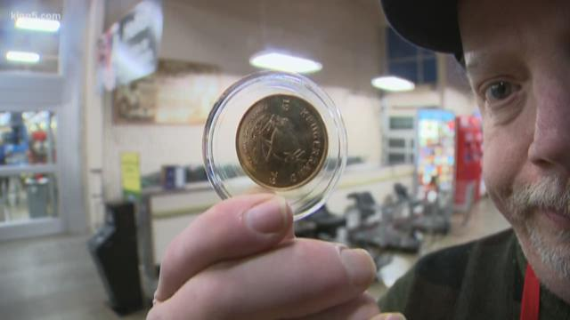 Anonymous donor drops gold coin in Red Kettle