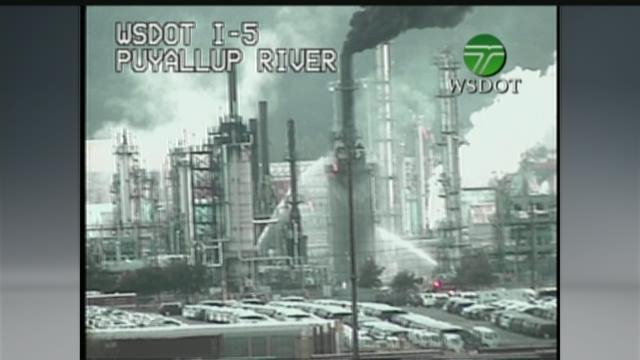 A crude oil fire burns in a stack at the U.S. Oil &